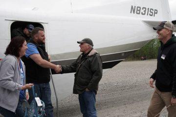Samaritan's Purse President Franklin Graham and Operation Heal Our Patriots Program Director John Pryor welcome Russell and Kerry to Samaritan Lodge Alaska.