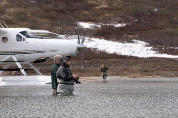 Russell enjoys fishing in the Alaskan wilderness.