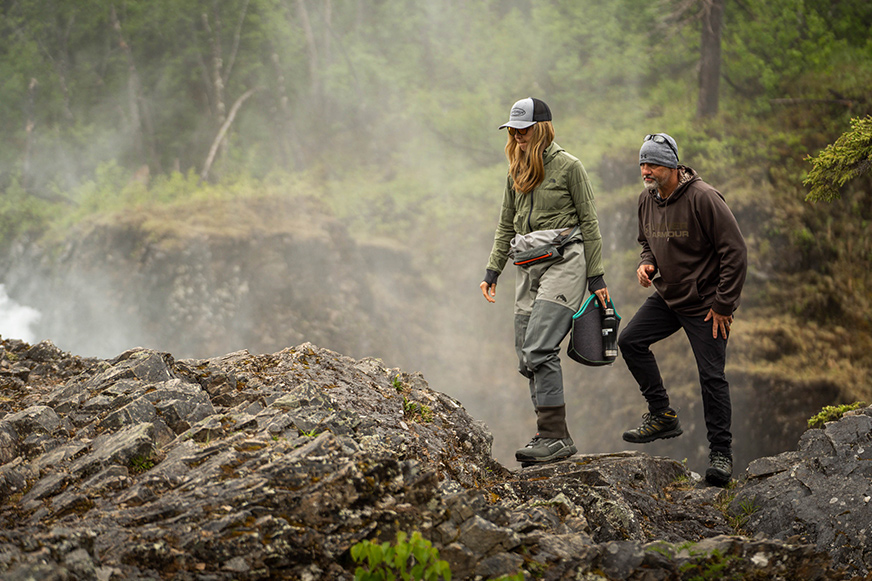 Military couples enjoy a hike to the top of Tanalian Falls in Lake Clark National Park.