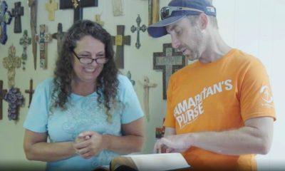 Samaritan's Purse volunteer presents Bible to homeowner