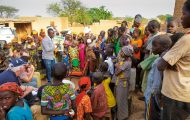 Nigerien villagers gather outside to hear a Gospel presentation by a local pastor and some of the Galmi Hospital missionary medical staff.