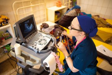 Dr. Katie Hoyt performs an ultrasound on a mother-to-be