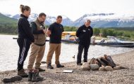 Trish Dawson joins her husband and our chaplains in prayer being baptized in Lake Clark.
