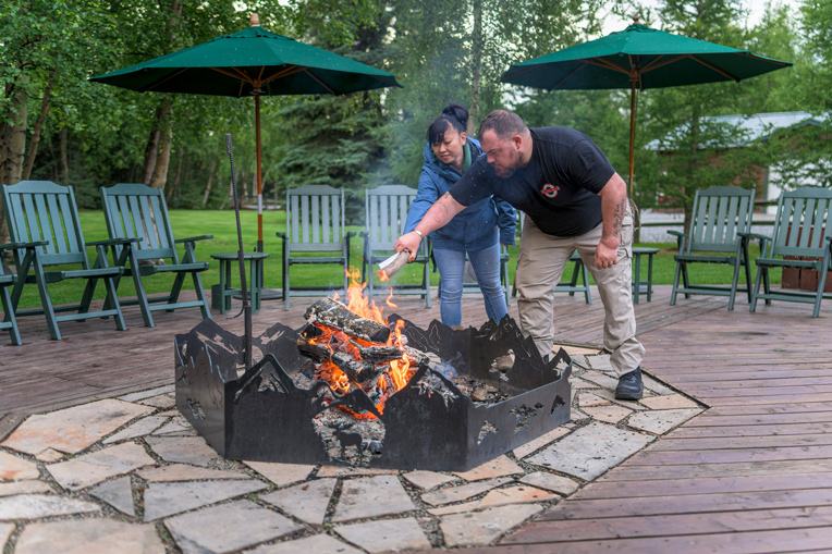 During a symbolic ceremony around the fire at Samaritan Lodge Alaska, the Reads and other couples burned a list of things they wanted to leave behind in Alaska.