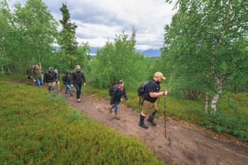 Marine Corporal Tim Read and his wife, Anh, lead the way to Tanalian Falls in Lake Clark National Park.