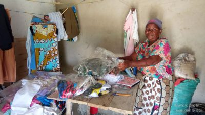 Rhoda has earned money selling goats, allowing her extra income for her sewing business.