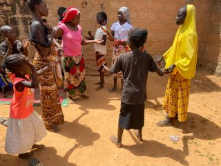 Families celebrate and praise God upon receiving food staples and cooking supplies after arriving in Niamey, Niger, with nothing.