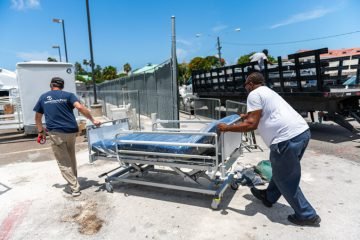 Resupply of the COVID-19 unit includes newly-arrived hospital beds.