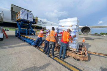 Teams in Port Au Prince are preparing relief cargo for transport to southern areas of the island.