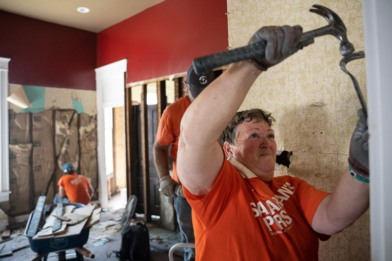 Site team leader Polly Gerwig works hard to remove damaged walls.