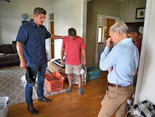 Edward Graham and Richard Furman spend time praying with Bradley.