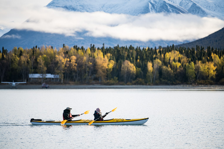 The first excursion couples enjoy is tandem kayaking in Lake Clark. This late fall week at Samaritan Lodge Alaska offered a backdrop of leaf change and snow caps.
