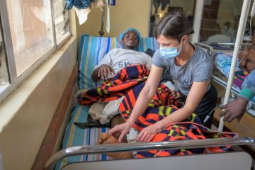 Dr. Julia Bedard checks on Moise the morning after his surgery.