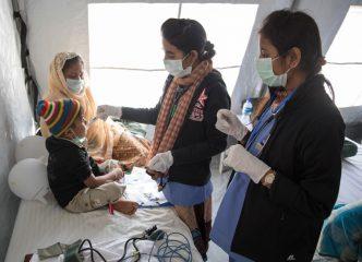 Nurses care for Mahamuda's grandson, Humial.