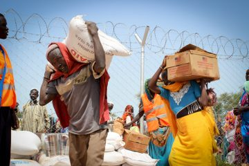 RefugeesreceivefoodrationsataSamaritan's Purse distribution.