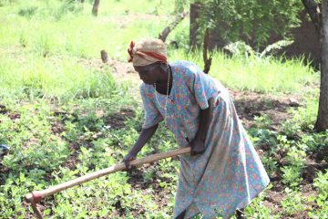 Rosemary tends her garden of plants grown from seeds provided by Samaritan's Purse.