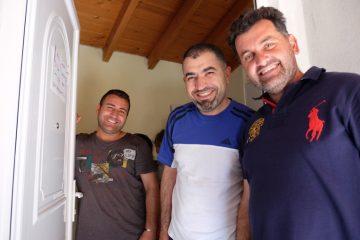 Savvas, right, is a church elder who serves refugee families.